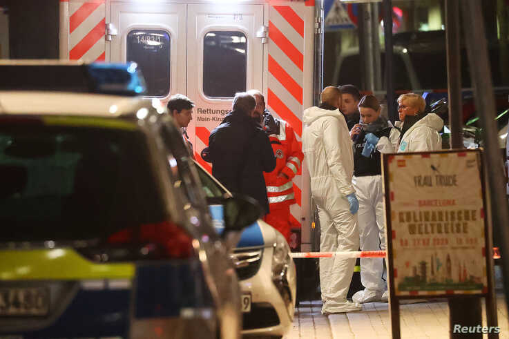 Forensic experts are seen outside a hookah bar after a shooting rampage in Hanau, Germany, Feb. 20, 2020.