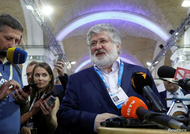 FILE - Ukrainian business tycoon and owner of one of Ukraine's largest media conglomerates, Igor Kolomoisky, speaks with journalists in Kyiv, Ukraine Sept. 13, 2019.