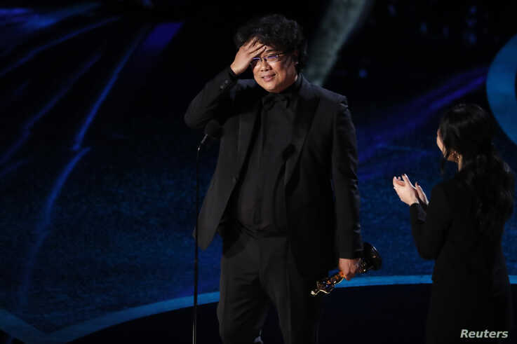 """Bong Joon Ho wins the Oscar for Best Director for """"Parasite"""" at the 92nd Academy Awards in Hollywood, Los Angeles, Calif., Feb. 9, 2020."""