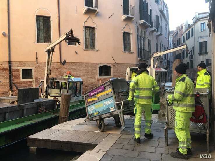 The total damage caused by November's winds and high tides has been estimated at over $500 million with the clean-up a work in progress. (Sabina Csatelfranco/VOA).