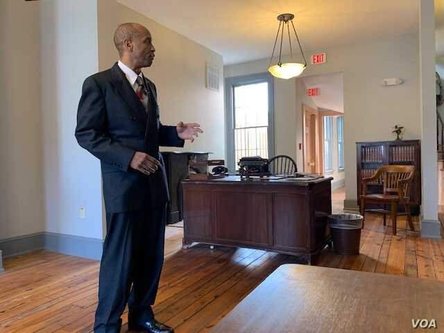 Actor Dexter Hamlett portrays Carter Woodson for tour groups that visit the home in Washington.