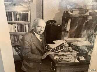 Carter Woodson is shown working in his home located in Washington's Shaw neighborhood during the 1940's.