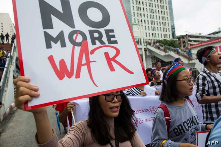 Ethnic Chin people hold placards during a protest asking for an end to conflict in Chin state and Rakhin State in Yangon on…