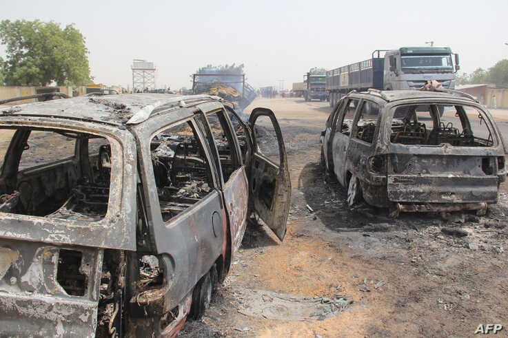 In this photograph taken in Auno on February 10, 2020, cars burnt down by suspected members of the Islamic State West Africa…