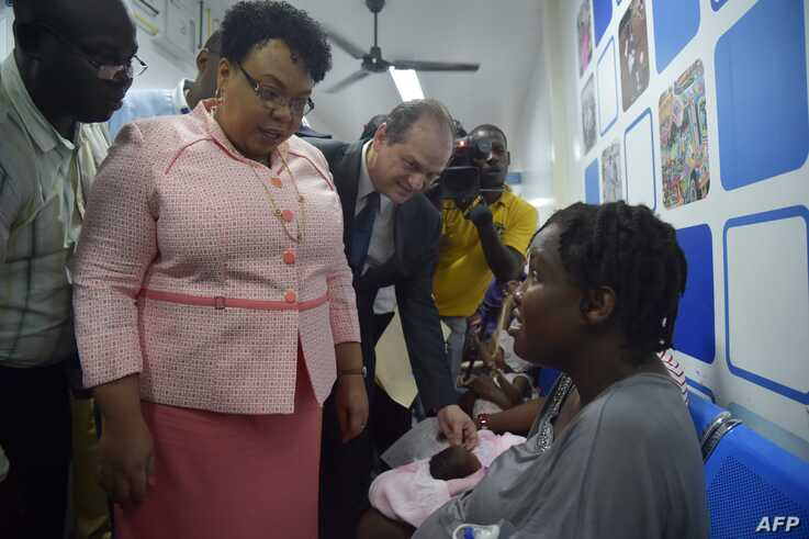 Minister of Public Health and Population of Haiti, Marie-Greta Roy Clément, left, and Minister of Health of Brazil Ricardo Barros, center, visit the Dr. Zilda Arns Lieu Hospital in Bon Repos, Port-au-Prince, June 23, 2017.