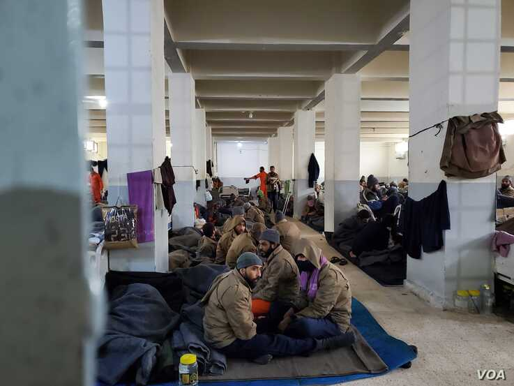 After Islamic State fell last year, men from all over the world were housed in prisons, pictured Feb. 16, 2020. Women and children were mostly brought to al-Hol Camp in Syria. (Heather Murdock/VOA)