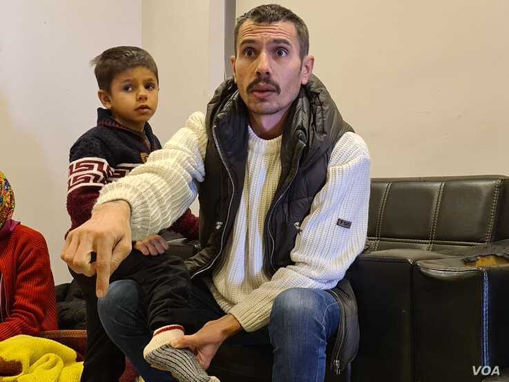 20200319_141924: Omar left Syria years ago, after narrowly escaping a beheading by Islamic State militants.  Now, he and his family are staying in a bus station after they were arrested and deported immediately after crossing into Greece on March 19, 2020 in Istanbul. (H.Murdock/VOA)