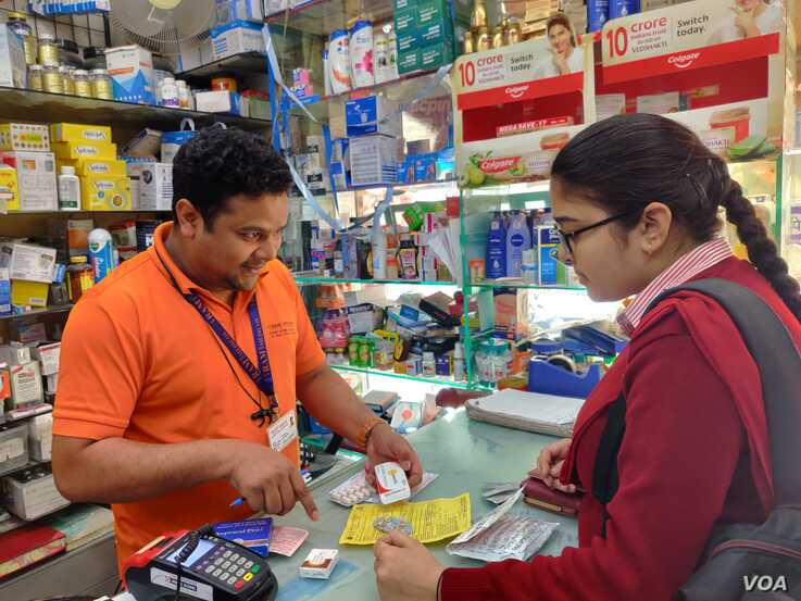 A young man buys medication at a pharmacy in New Delhi, March 6, 2020. (A. Pasricha/VOA). India is one of the world's major producers of affordable drugs.