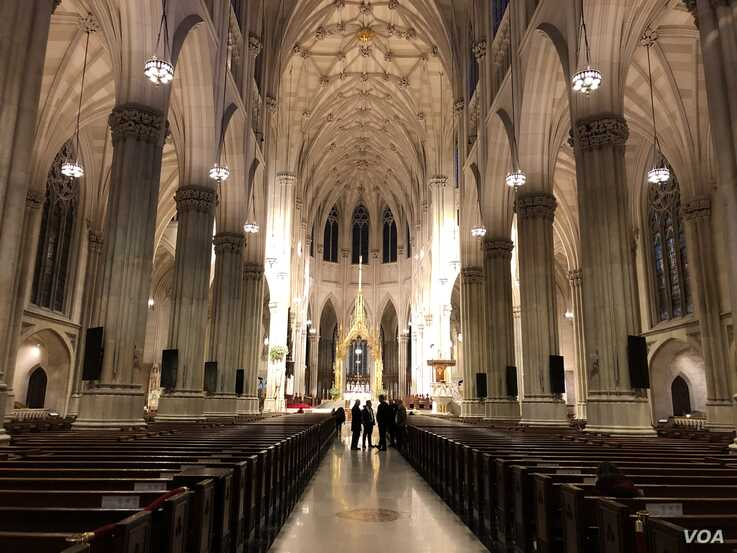 The nearly empty interior of St. Patrick's Cathedral is seen in New York, March 17, 2020. (Margaret Besheer/VOA)