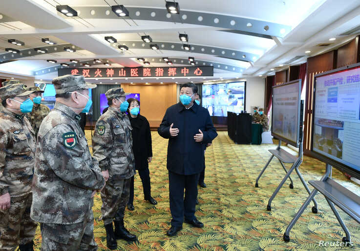 Chinese President Xi Jinping learns about the hospital's operations, treatment of patients, protection for medical workers and scientific research in Wuhan, the epicentre of the novel coronavirus outbreak, Hubei province, China, March 10, 2020.