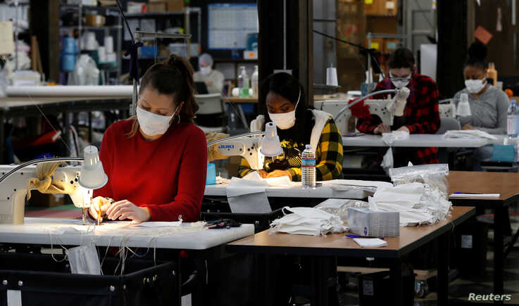Jennifer Nagle sews hospital masks as the spread of coronavirus disease (COVID-19) continues, on day one of turning the …