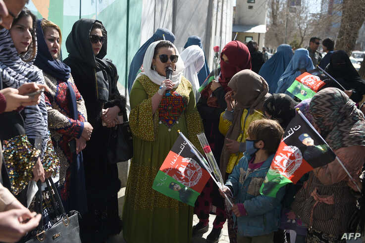 FILE - Afghan civil society activists are seen gathered during International Women's Day, in Kabul, Afghanistan, March 8, 2020.
