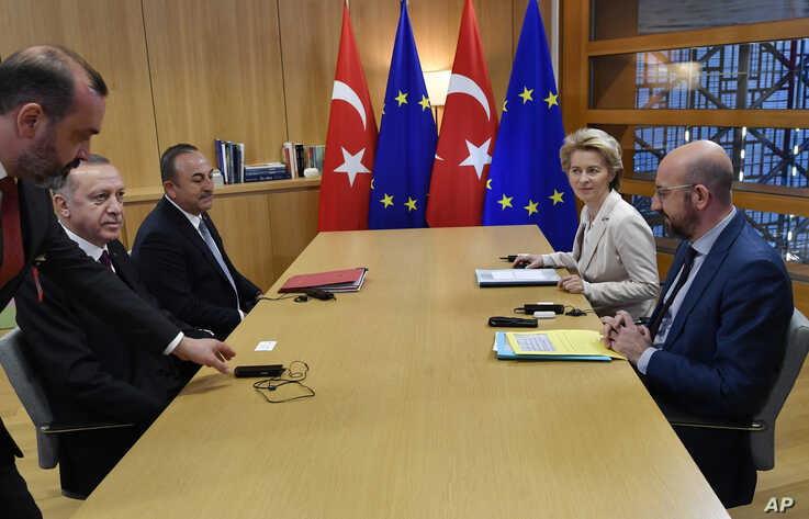 Turkish President Recep Tayyip Erdogan, second left, meets with European Council President Charles Michel, right, and European Commission President Ursula von der Leyen, second right, at the European Council building in Brussels, Belgium, March 9, 2020.