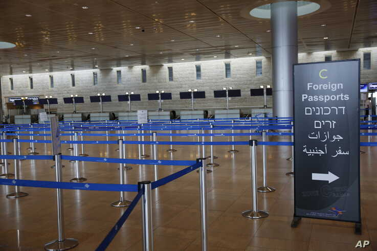 Check-in counters are empty at the Ben Gurion Airport near Tel Aviv, Israel, March 10, 2020.