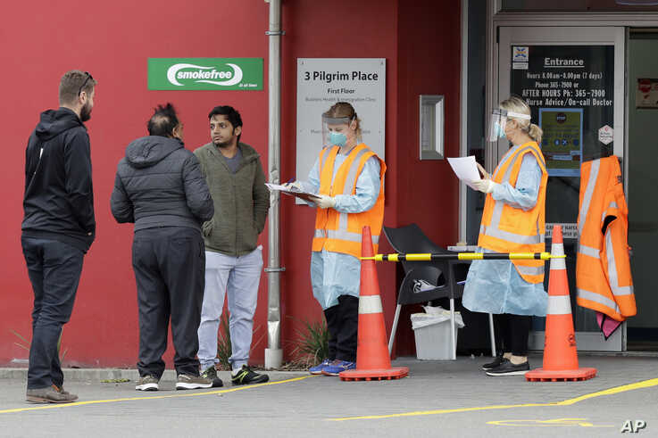Patients are screened before entering a medical center in central Christchurch, New Zealand, March 24, 2020.
