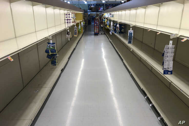 Empty shelves are seen at a grocery store in Willow Grove, Pennsylvania, March 16, 2020, as shoppers have been buying up extra quantities of the products since the outbreak of the coronavirus.