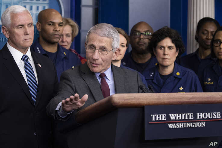 Dr. Anthony Fauci, director of the National Institute of Allergy and Infectious Diseases, with Vice President Mike Pence behind him, speaks during a briefing about the coronavirus in the James Brady Press Briefing Room of the White House, March 15, 2020, in Washington.
