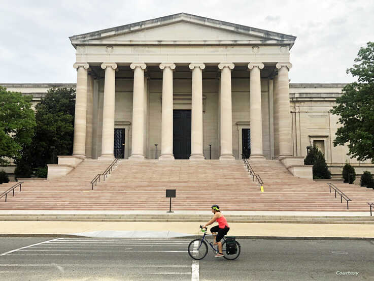 A woman is biking past the National Gallery of Art in a usually busy part for tourists in Washington DC. (Photo: Diaa Bekheet)