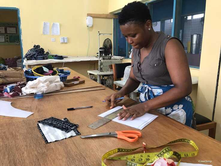 Global Mamas' sewing instructor and technical designer Elizabeth Adams prepares a pattern for the fabric face masks. (Photo Courtesy of Global Mamas)