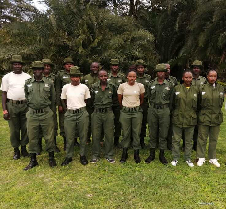 Female rangers at the Olgulului-Ololarashi Group Ranch pose for a group photo with their male colleagues. (Courtesy - Patrick Papatiti, Commander of the Olgululului Community Wildlife Rangers)