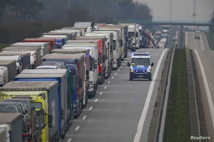A police vehicle is seen passing a truck back-up near the German-Polish border, near Frankfurt an der Oder, during the coronavirus outbreak in Germany, March 19, 2020.