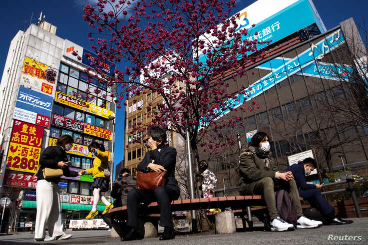 People wearing protetive masks amid an outbreak of the coronavirus are seen in front of Nakano station in Tokyo, Japan, March 5, 2020.