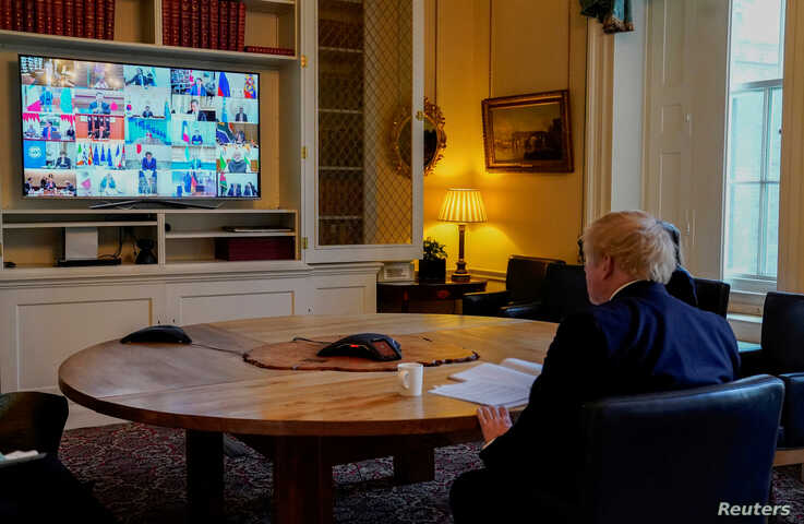 Britain's Prime Minister Boris Johnson attends a video conference in the study of 10 Downing Street in London, with other G-20 leaders summit, March 26, 2020.