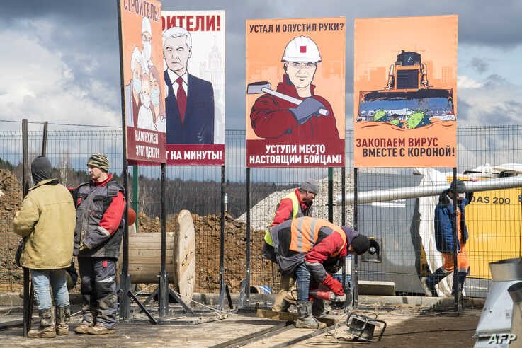 Workers finish construction of a new hospital for coronavirus patients outside the village of Golokhvastovo, some 60 kilometres…
