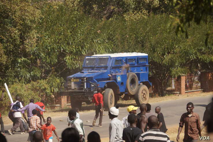 FILE - Protesters pelt police vehicles with stones in Lilongwe in this undated photo. Angry prison guards in Malawi attacked armory vehicles when police tried to stop their strike, April 24, 2020. (Lameck Masina/VOA)