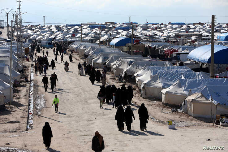 FILE - This April 19, 2020 photo shows a large refugee camp on the Syrian side of the border with Turkey, near the town of Atma, in Idlib province, Syria.