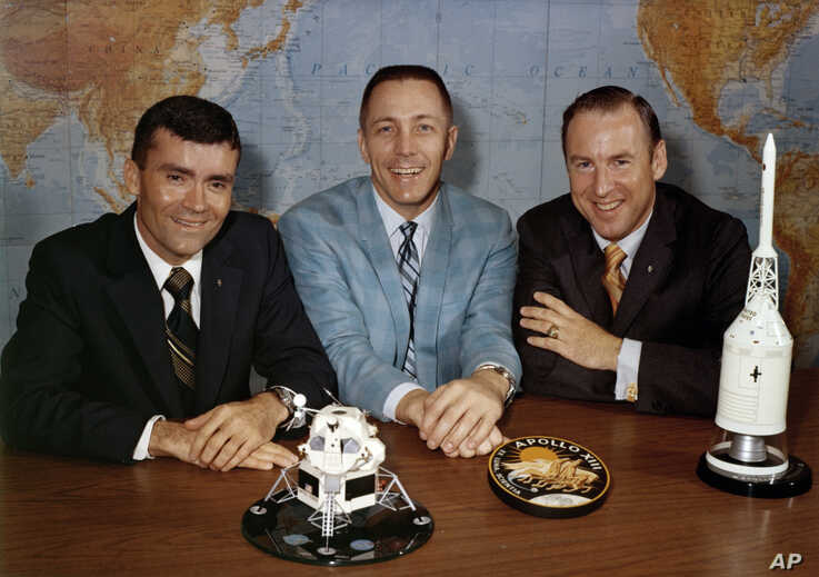 FILE - In this April 10, 1970, photo made available by NASA, Apollo 13 astronauts, from left, Fred Haise, Jack Swigert and Jim Lovell pose for a photo on the day before launch.