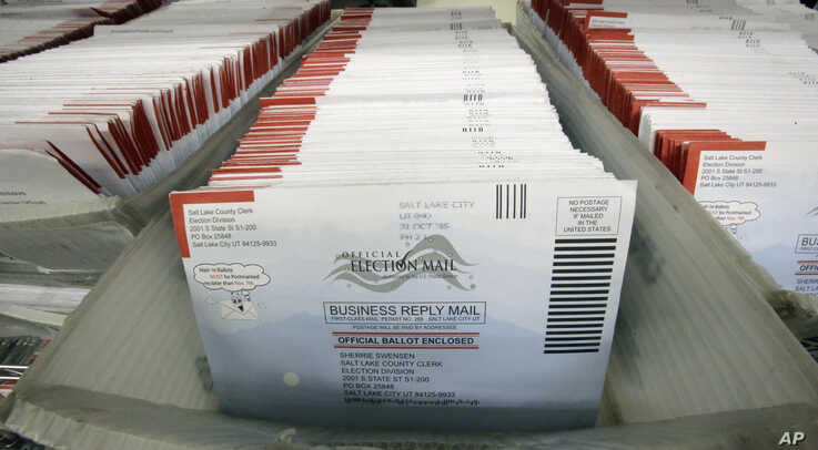 FILE - Mail-in ballots for the 2016 U.S. general election are seen at the Salt Lake County Government Center, in Salt Lake City, Utah, Nov. 1, 2016.