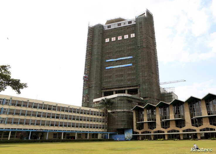 Ongoing construction work by Chinese state-owned firms is seen at the University of Nairobi, Kenya September 2, 2015. Picture…