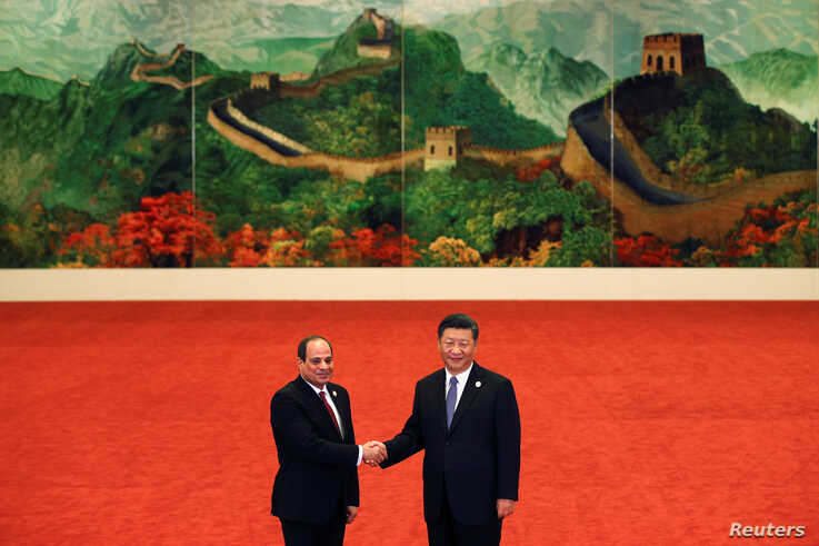 Egypt's President Abdel Fattah al-Sisi, left, shakes hands with Chinese President Xi Jinping during the Forum on China-Africa…