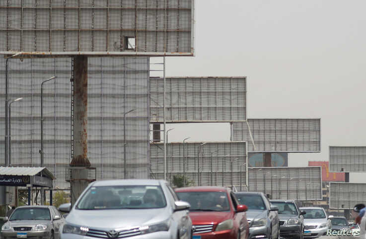 Cars drive past the blank billboards on the 6th of October Bridge, amid concerns over the coronavirus disease (COVID-19) in…