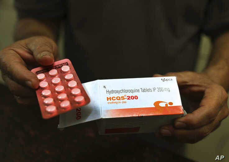 FILE - In this Thursday, April 9, 2020 file photo, a chemist displays hydroxychloroquine tablets in New Delhi, India…