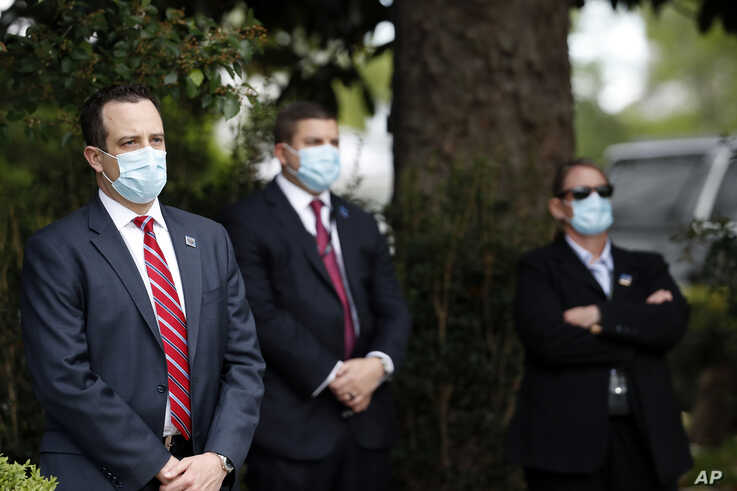 Members of the U.S. Secret Service stand at their posts as President Donald Trump speaks about the coronavirus during a press…