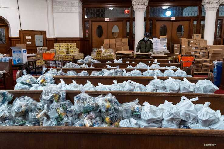 Food packages are organized at Evangel Church in Long Island City, to be distributed by New York Cares volunteers to those in need. (Photo courtesy New York Cares)