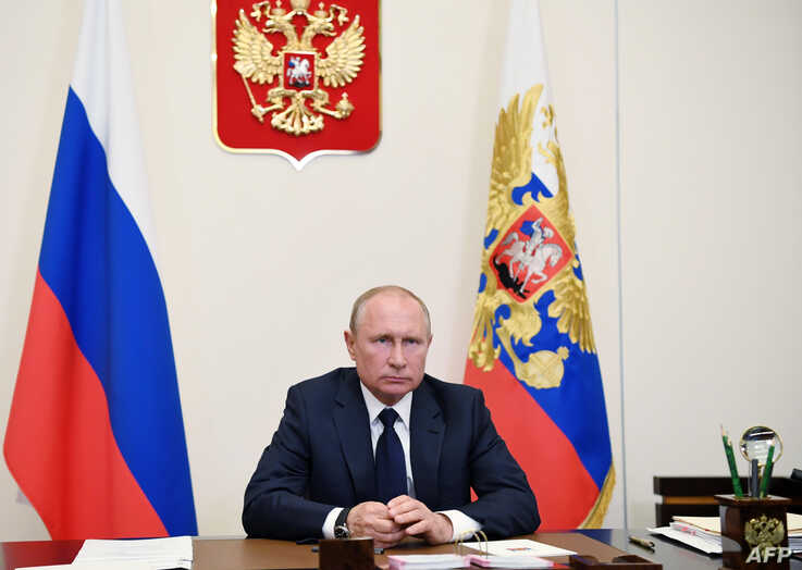 FILE - Russian President Vladimir Putin is seen during a teleconference at the Novo-Ogaryovo state residence, outside Moscow, May 11, 2020.