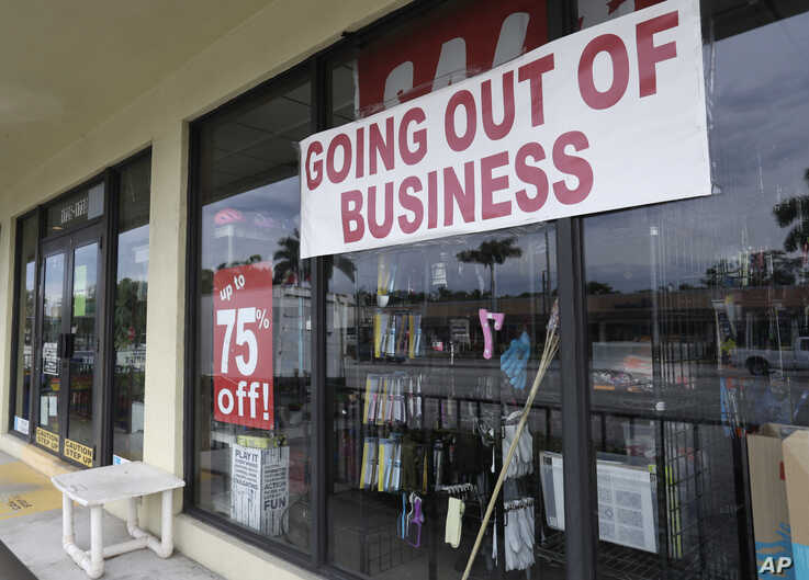"FILE - A store front with a ""Going Out of Business"" sign is seen in North Miami Beach, Florida, April 30, 2020."