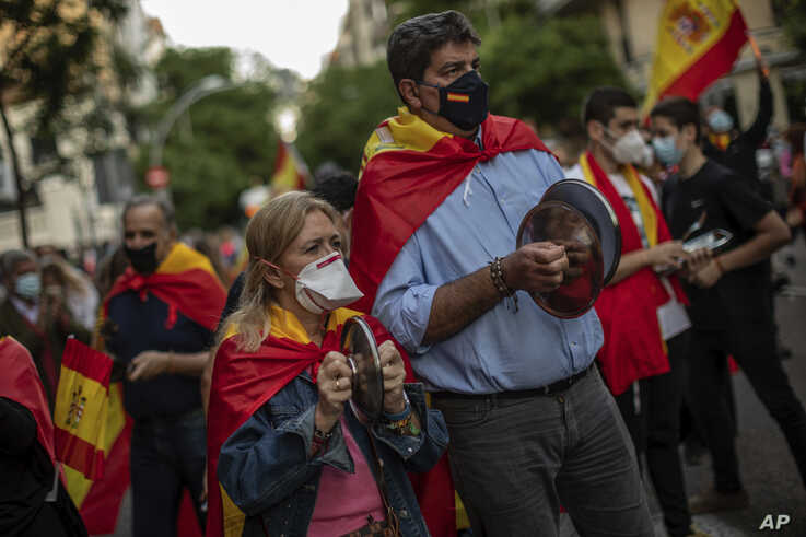 People take part in a protest against the Spanish government amid the lockdown to prevent the spread of coronavirus in Madrid, Spain, May 18, 2020.