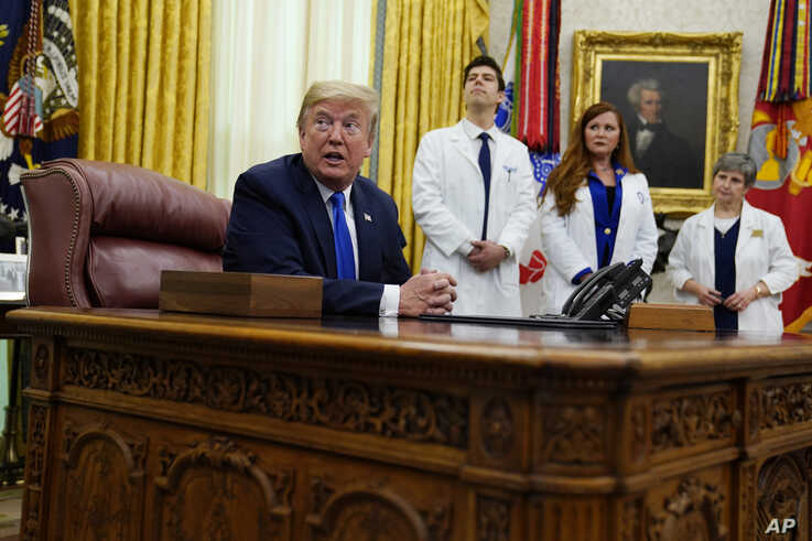 President Donald Trump speaks during an event to sign a proclamation in honor of World Nurses Day, in the Oval Office of the White House, in Washington, May 6, 2020.
