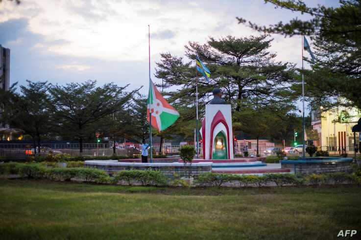 The Burundian national flag is taken down at the independent square in downtown Bujumbura as Burundi mourns the death of…