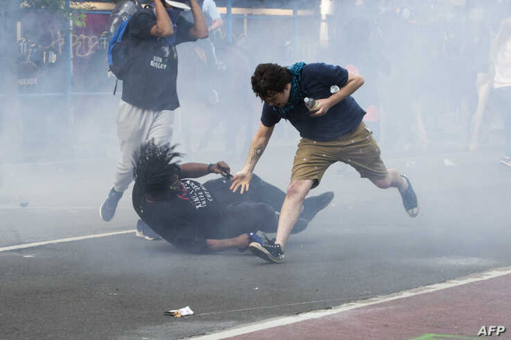 Protesters are tear gassed as the police disperse them near the White House in Washington, D.C., June 1, 2020 for President Donald Trump to be able to walk through for a photo opportunity in front of St. John's Episcopal Church in Washington, June 1.