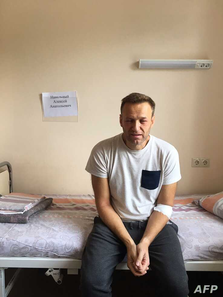 A handout image made available on the official website of Russia's opposition leader Alexei Navalny (Navalny.com) on July 29, 2019, shows Russia's jailed opposition leader Alexei Navalny sitting on a hospital bed in Moscow.