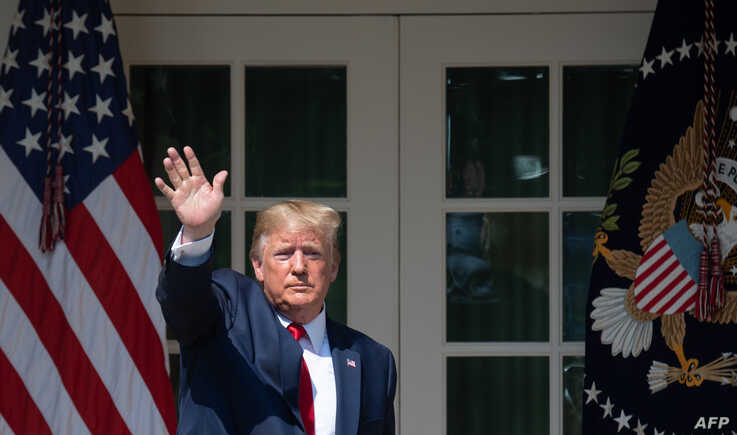 US President Donald Trump waves after signing HR 1327, an act to permanently authorize the September 11th victim compensation fund, during a ceremony in the Rose Garden of the White House in Washington, DC, July 29, 2019. / AFP / SAUL LOEB