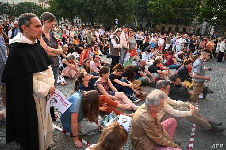 People pray for Vincent Lambert, who is in a vegetative state since 2008, in Paris on July 10, 2019. Vincent Lambert, 42, has been in a vegetative state since a 2008 traffic accident, but the question of whether to continue keeping him alive…