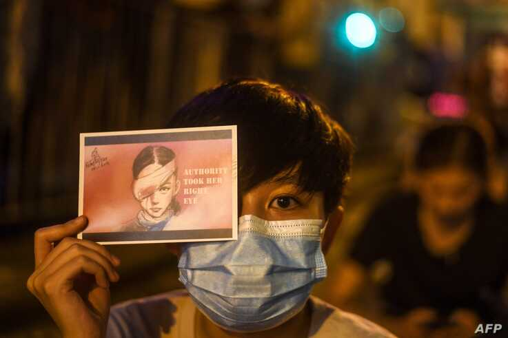 A pro-democracy protester holds a sign while attending a rally in Hong Kong Aug. 16, 2019.