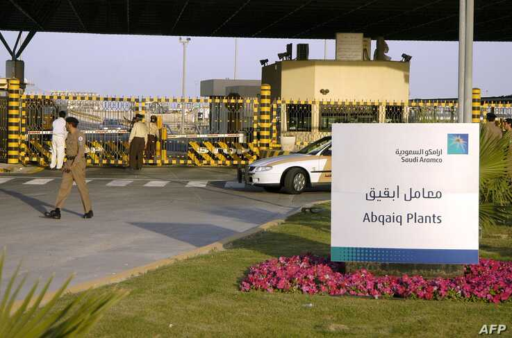 (FILES) In this file photo taken on February 25, 2006 Saudi security guard the entrance of the oil processing plant of the Saudi state oil giant Aramco in Abqaiq in the oil-rich Eastern Province. Drones struck two Saudi Aramco oil facilities early…