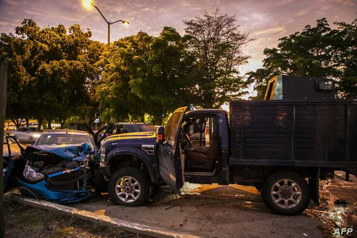 EDITORS NOTE: Graphic content / View of bullet ridden and crashed vehicles in a street of Culiacan, state of Sinaloa, Mexico,…